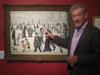 Ian McKellen with <em>The Cripples</em> by LS Lowry