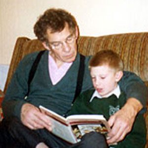 1996,   Reading to my nieces son Robert Blackman