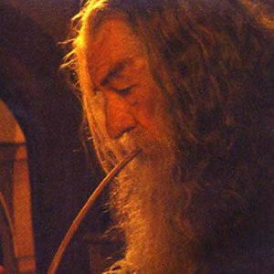 2001, THE LORD OF THE RINGS: THE FELLOWSHIP OF THE RING: Gandalf with pipe  - Photo by Pierre Vinet/New Line Cinema