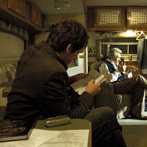 2005, THE DA VINCI CODE: Matt Butler, a friend who is playing a plainclothes detective in The Da Vinci Code, gallantly hearing me learn my lines in my trailer, Shepperton Studios, August 2005  - Photo by Keith Stern