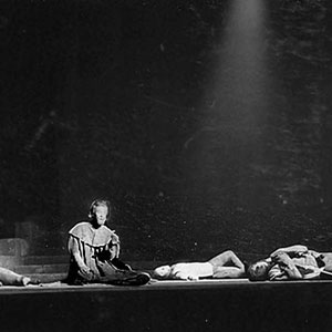 1961, HENRY VI PARTS 2 AND 3 (Cambridge): King Henry (Ian McKellen, center) and Lord Sal (Trevor Nunn, prone right)