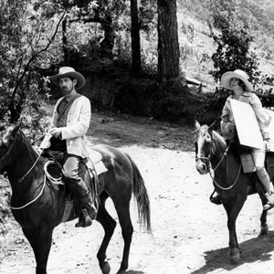 1979, PRIEST OF LOVE: Riding with amanuensis  Brett (Penelope Keith) on a painting expedition. <BR><BR><em>Lawrence was a considerable amateur painter &#151; </em>Priest of Love<em> opened with the banning of a London exhibition of his oils, on the grounds of obscenity. Acting on horseback is not easy &#151; the animal is so resolutely itself, unabashed by the camera's attention, whilst the rider has to be in control, yet relaxed enough to remain in character.  I had learnt to ride safely when I was initially cast as Ned Kelly for Tony Richardson's film about the Australian outlaw.  Mick Jagger eventually played the part.</em>