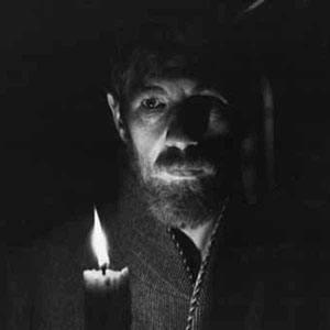 1979, PRIEST OF LOVE: Lawrence (Ian McKellen) off to bed <BR><BR><em>This scene showed me candlelit moving round the marital bed &#151; in shadow I displayed the first erection ever seen in a mainstream movie.  This was achieved with a dildo and a great deal of sticking-plaster.</em>