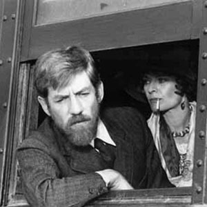 1979, PRIEST OF LOVE: Frieda and D. H. Lawrence journeying to New Mexico <BR><BR><em>My hair was dyed auburn, like Lawrence's own. My moustache and beard were augmented by some false hair around the chin.</em>