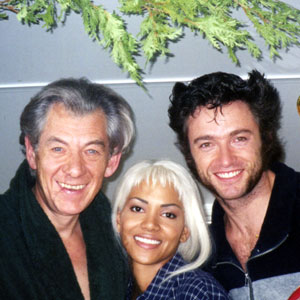 1999, X-MEN: Ian McKellen (Magneto), Halle Berry (Storm), and Hugh Jackman (Wolverine) take a Christmassy break in the makeup trailer, Toronto