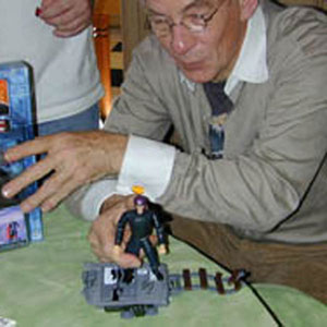 2000, X-MEN: Playing with Magneto action figure  - Photo by Keith Stern