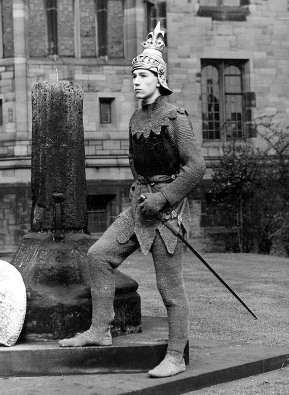 <em>Posing outside the Great Hall.  Out of shot, some seniors from the Girls' Division giggled at me but I felt confident in the hired chainmail and the papier-mache helmet, stuffed with the Bolton Evening News to keep it secure.</em> — Ian McKellen, December 2006<br /><em>Percy C Rising</em>
